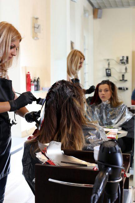 Hairdresser salon. Woman during haircut
